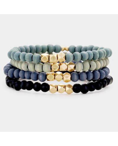 Quatre bracelets extensibles à perles en bois à facettes